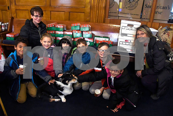 11/14/2017 Mike Orazzi | Staff Immanuel Lutheran School students as they drop off boxes of donated items for Operation Christmas Child at the Calvary Advent Church in Bristol Tuesday afternoon. With them is parent volunteer Heather Correa and teacher Linda Beaudoin.