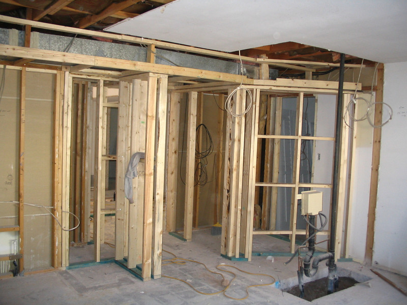 Kitchen: you can see what will become the wine cellar, the hall into the living room, and the wall (to the left) that will hold the kitchen cabinets, including the pantry.