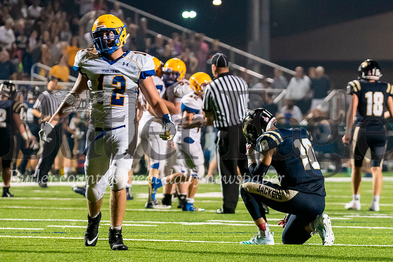 Freeport's Evan McCrea (10) drops to his knee as Derry's Dom DeLuca (12) celebrates following a Derry interception on the final play of Freeport's overtime possession on Friday, Aug. 31, 2018 at Freeport Area Athletic Stadium. Derry won 19-13.