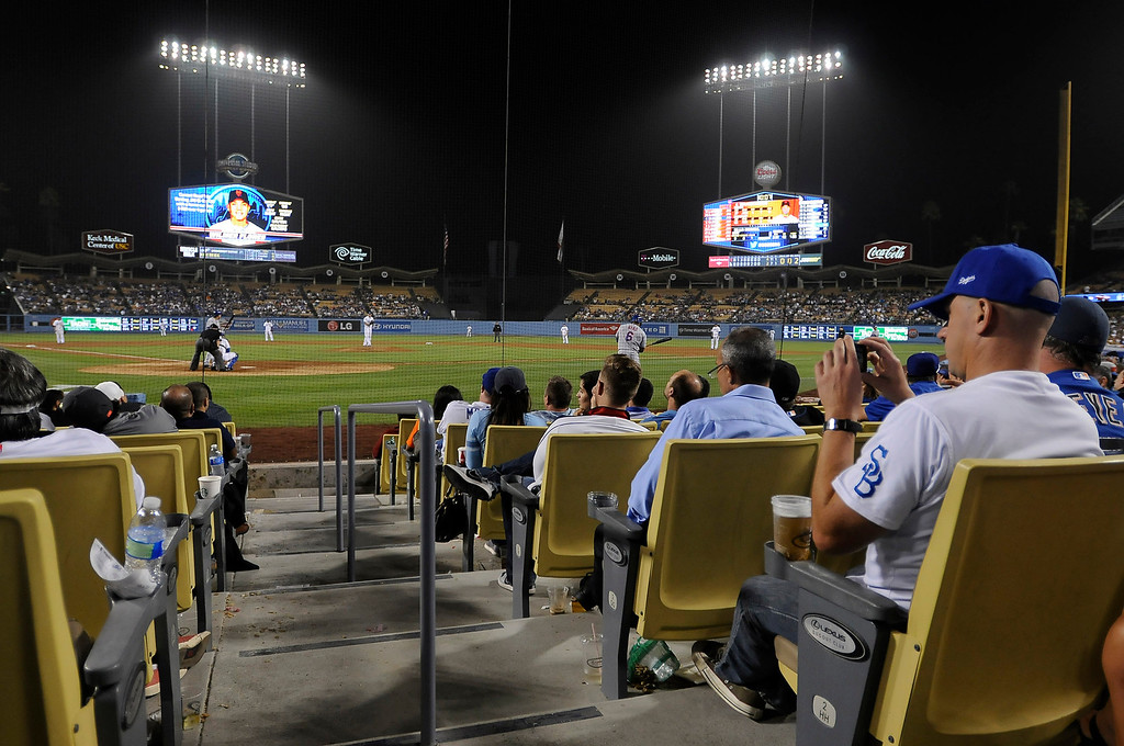 . New big screens in the outfield, and premium seating behind home plate add to the fan experience. Fans at Dodger Stadium have been treated to a lot of excitement. The Dodgers defeated the New York Mets 5-4 in 12 innings Wednesday night at Dodger Stadium in Los Angeles, CA. 8/13/2013(John McCoy/LA Daily News)