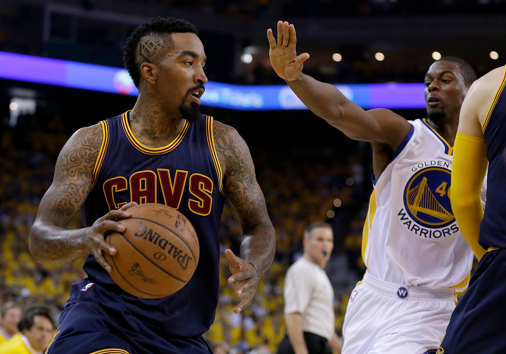 . Cleveland Cavaliers guard J.R. Smith dribbles against Golden State Warriors forward Harrison Barnes (40) during the first half of Game 1 of basketball\'s NBA Finals in Oakland, Calif., Thursday, June 4, 2015. (AP Photo/Ben Margot)
