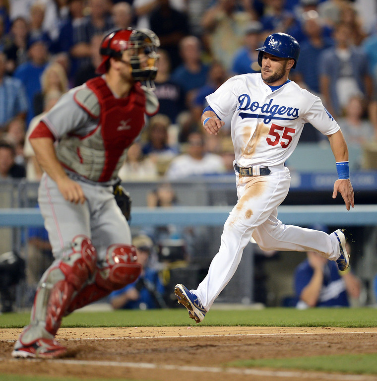 . The Dodgers Skip Schumaker #55 scores in the 7th inning during their game against the Reds at Dodger Stadium in Los Angeles Saturday, July 27, 2013. The Dodgers beat the Reds 4-1. (Hans Gutknecht/Los Angeles Daily News)