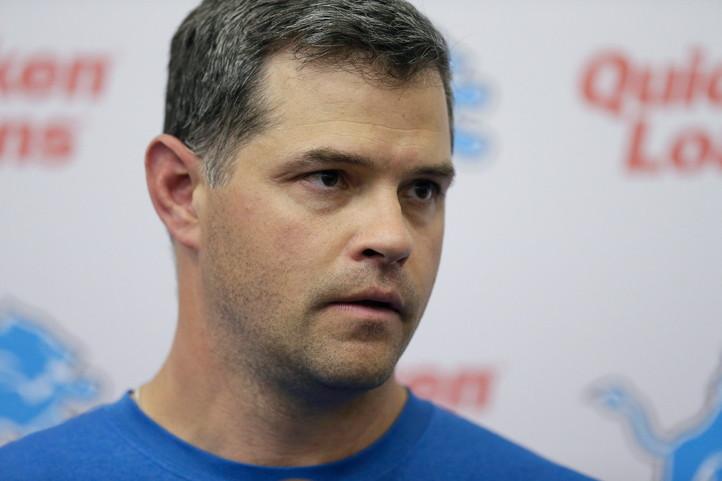 . Detroit Lions offensive coordinator Joe Lombardi talks with the media after an NFL football organized team activity in Allen Park, Mich., Wednesday, May 28, 2014. (AP Photo/Carlos Osorio)