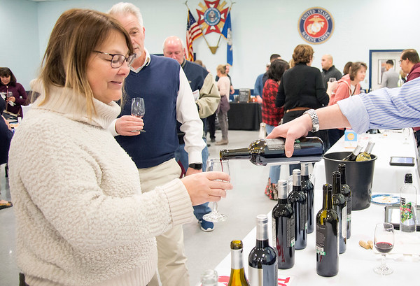 02/27/20 Wesley Bunnell | StaffrrA wine tasting was held on Thursday night with proceeds benefiting Wreaths Across America was held at the New Britain VFW Post. Penny Hill and Pierre Hill sample the wine selection at the Allan S. Goodman table which was staffed by Michael Greenberg.