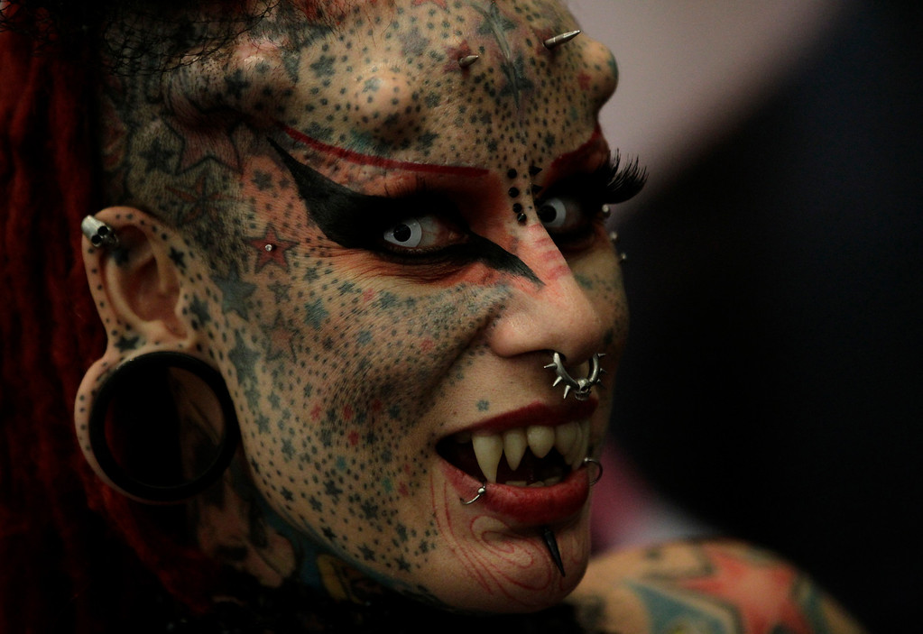 . Tattoo artist Maria Jose Cristerna of Mexico attends the Tattoo Art Mex 2012 convention at the World Trade Center in Mexico City August 5, 2012. The convention, which brought together dozens of Mexico City tattoo artists and drew hundreds of tattoo enthusiasts, also showcased body modification, body painting, graffiti and displays of colorfully decorated cars. REUTERS/Henry Romero