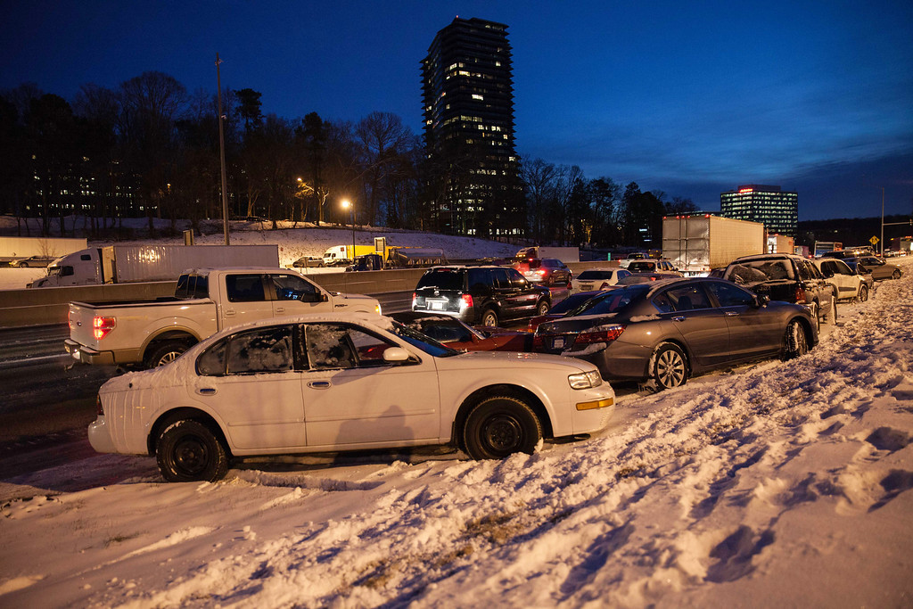 . Abandoned vehicles line  I-285 early Wednesday, Jan. 29, 2014, in Dunwoody, Ga., after a rare  winter storm hit Georgia.  While such amounts barely qualify as a storm in the north, it was enough to paralyze the Deep South.  (AP Photo/Branden Camp)
