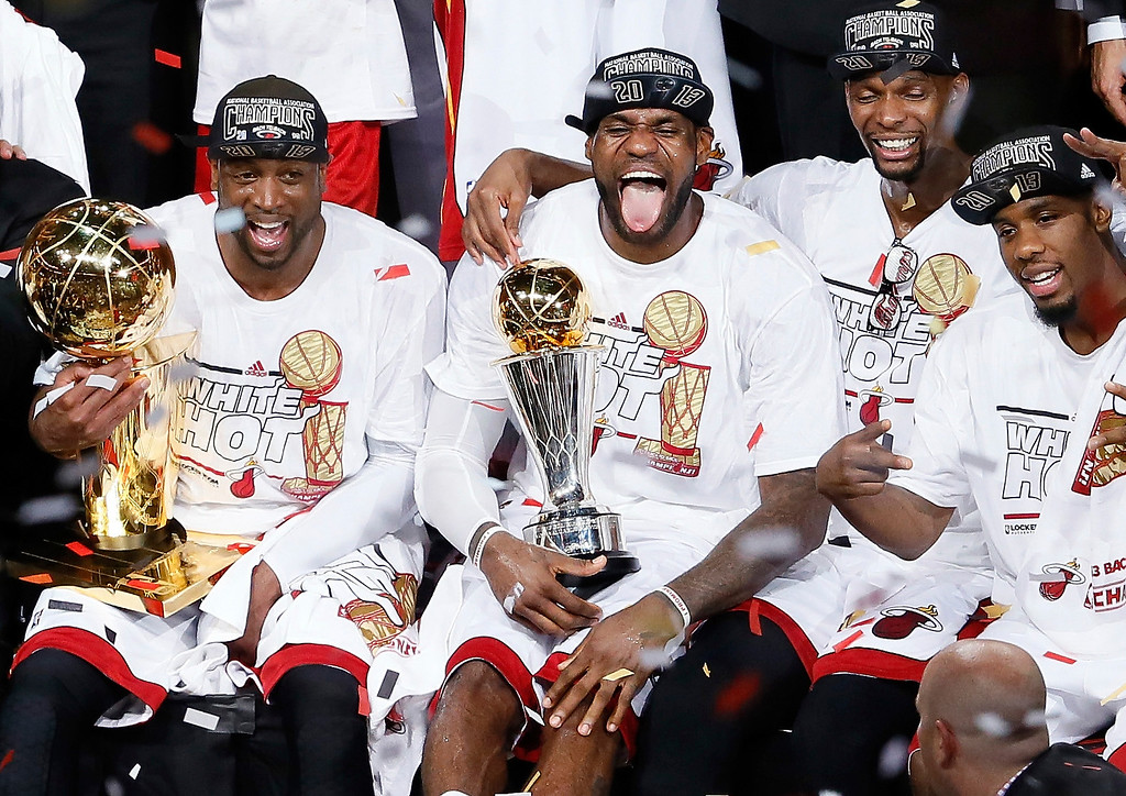 . Dwyane Wade #3, LeBron James #6, Chris Bosh #1 and Norris Cole #30 of the Miami Heat celebrate after defeating the San Antonio Spurs 95-88 to win Game Seven of the 2013 NBA Finals at AmericanAirlines Arena on June 20, 2013 in Miami, Florida.  (Photo by Kevin C. Cox/Getty Images)