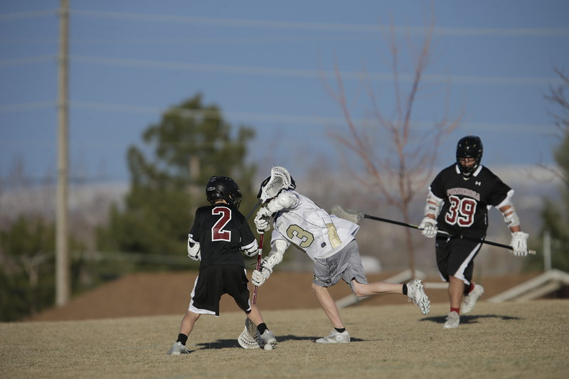 JPM0486-JPM0486-Jonathan first HS lacrosse game March 9th.jpg