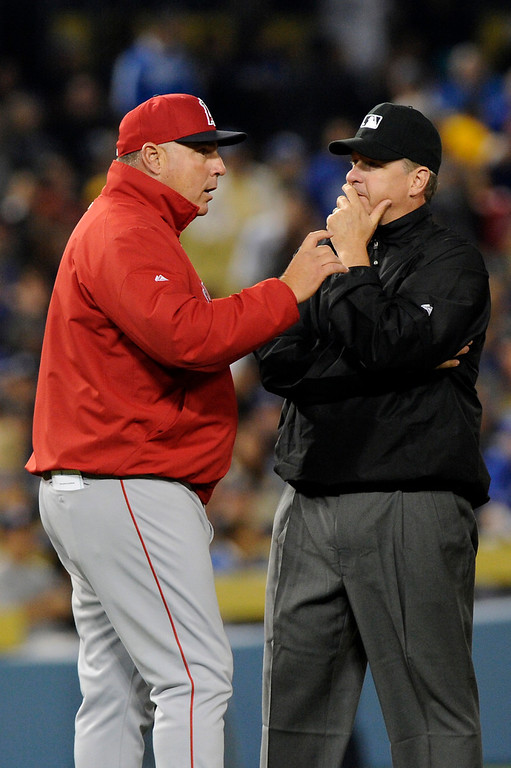. Angels manager Mike Scioscia argues with an umpire that the infield fly full should have been called when shortstop Erick Aybar dropped a flyball by the Dodgers\' Adrian Gonzalez allowing a run to score in the second inning, Friday, March 29, 2013, at Dodger Stadium. (Michael Owen Baker/Staff Photographer)