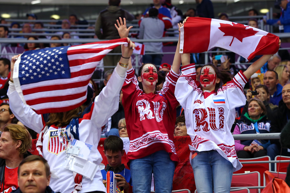 . United States and Canada fans attend the Men\'s Ice Hockey Semifinal Playoff between Canada and the United States on Day 14 of the 2014 Sochi Winter Olympics at Bolshoy Ice Dome on February 21, 2014 in Sochi, Russia.  (Photo by Martin Rose/Getty Images)