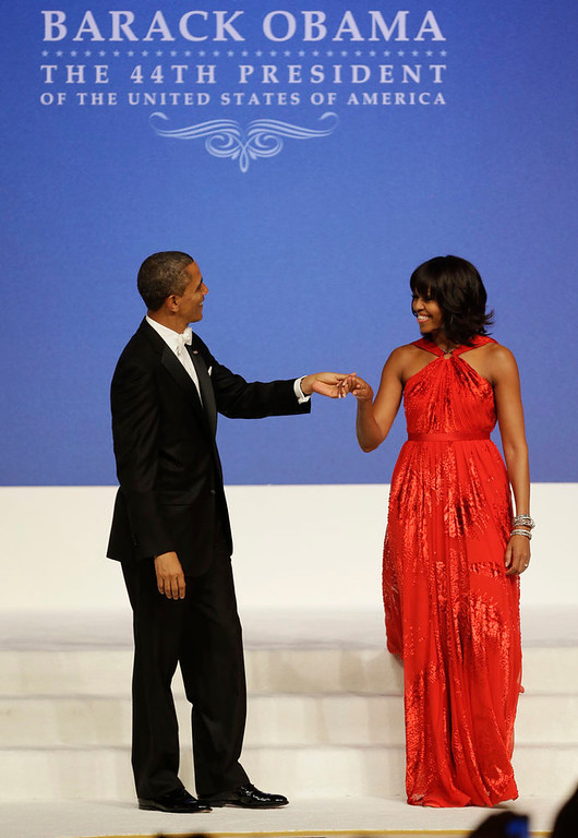 . President Barack Obama and first lady Michelle Obama dance at Commander-in-Chief\'s Inaugural Ball at the 57th Presidential Inauguration in Washington, Monday, Jan. 21, 2013. (AP Photo/Jacquelyn Martin)