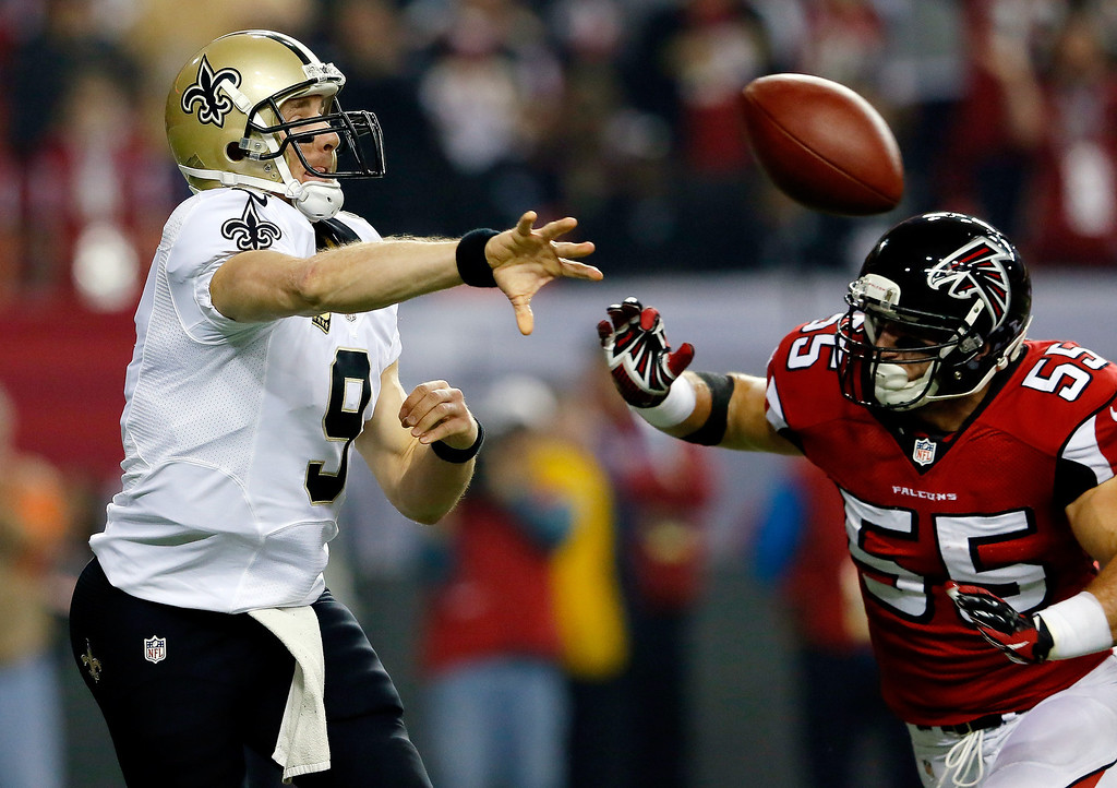 . Quarterback Drew Brees #9 of the New Orleans Saints is pressured by outside linebacker Paul Worrilow #55 of the Atlanta Falcons during a game at the Georgia Dome on November 21, 2013 in Atlanta, Georgia.  (Photo by Kevin C. Cox/Getty Images)