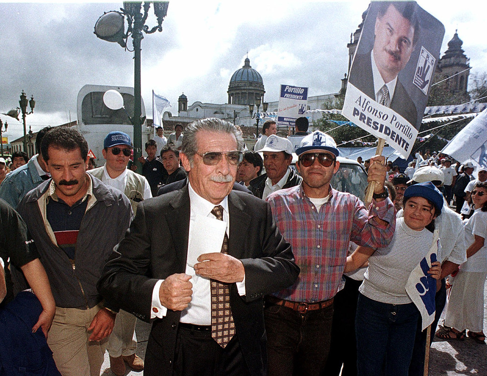 . Retired General Jose Efrain Rios Montt, left, founder of the  Guatemalan Republican Front Party (FRG) is shown as the final week of campaigning begins, Sunday , Oct. 31, 1999, in Guatemala City.  Alfonso Portillo of the Guatemalan Republican Front Party and Oscar Berger of the ruling National Advancement Party (PAN), are the main candidates of the Nov. 7 election. (AP Photo/Moises Castillo)