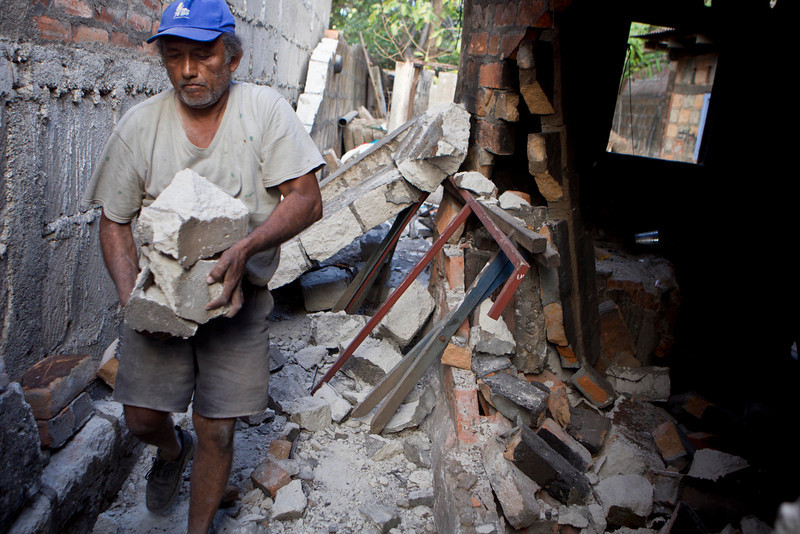 . A man carries the remains of the wall of his home, damaged by an earthquake in Nagarote, Nicaragua, Friday, April 11, 2014. Nicaragua\'s President Daniel Ortega declared red alert Friday after an earthquake of 6.2 magnitude on the Richter scale that shook the country on Thursday and left one dead, hundreds of houses damaged and thousands of people affected . (AP Photo/Esteban Felix)