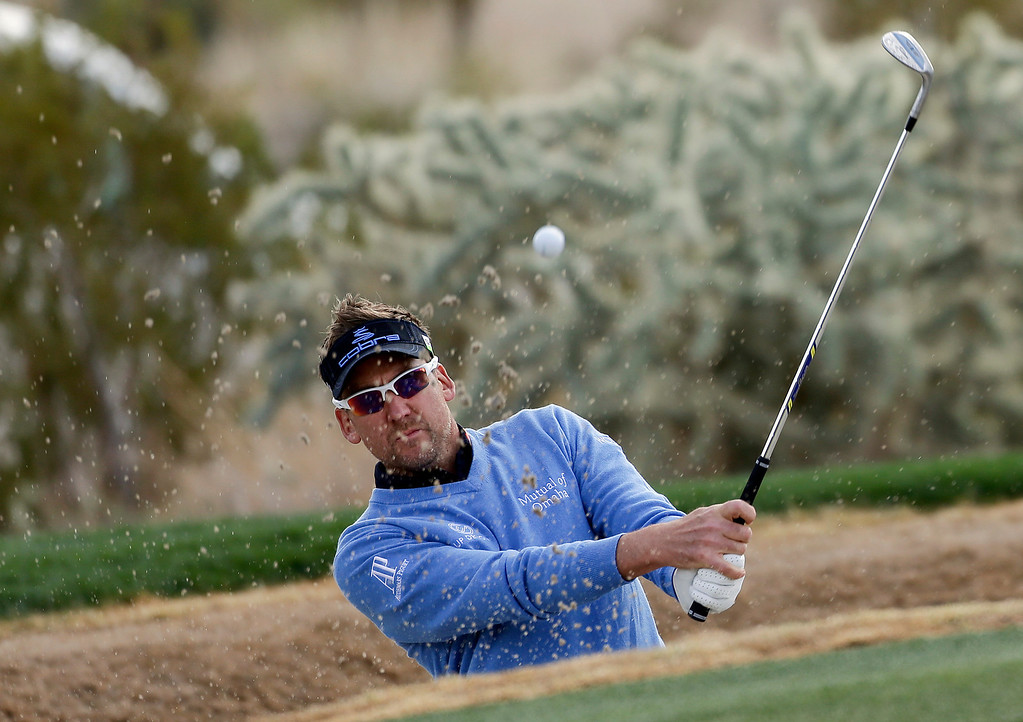 . England\'s Ian Poulter hits out of a bunker onto the 16th green during the first round of the Match Play Championship golf tournament, Thursday, Feb. 21, 2013, in Marana, Ariz. (AP Photo/Julie Jacobson)