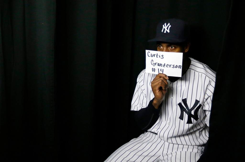 . New York Yankees center fielder Curtis Granderson poses in a photo booth during the team\'s photo day at baseball spring training, Wednesday, Feb. 20, 2013, in Tampa, Fla. (AP Photo/Matt Slocum)