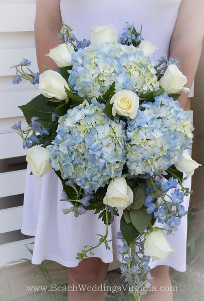 white roses, blue hydrangea, blue delphinium, cascading