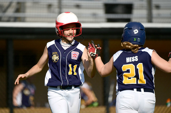 7/24/2019 Mike Orazzi | Staff Connecticut's Angelina Robinson (11) and Grace Hess (21) during Wednesday's Little League softball game at Breen Field in Bristol.