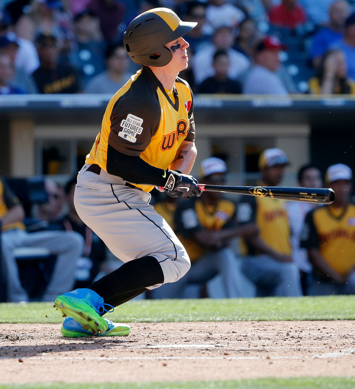 . World Team\'s Tyler O\'Neill, of the Seattle Mariners, hits against the U.S. Team during the third inning of the All-Star Futures baseball game, Sunday, July 10, 2016, in San Diego. (AP Photo/Lenny Ignelzi)