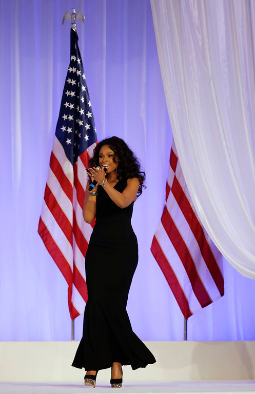 . Jennifer Hudson sings while President Barack Obama and his wife Michelle dance at the Inaugural Ball at the 57th Presidential Inauguration in Washington, Monday, Jan. 21, 2013. (AP Photo/Paul Sancya)