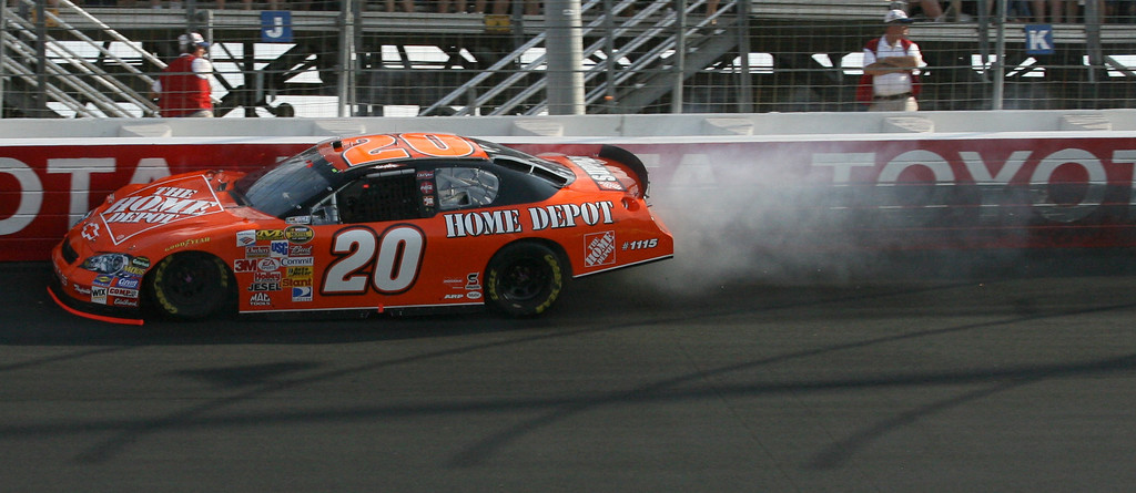 . Tony Stewart (20) crashes during the NASCAR Nextel Cup Series Coca-Cola 600 auto race at Lowe\'s Motor Speedway in Concord, N.C., Sunday May 28, 2006. (AP Photo/Nathan Armes)