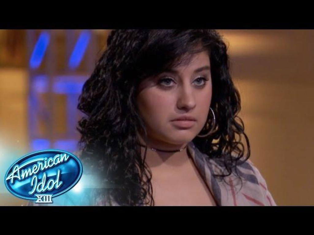 """. Jene Irene of Farmington Hills waits for judges to tell her if she was going home or moving into the Top 30 on \""""American Idol.\"""" Photo courtesy of Fox"""