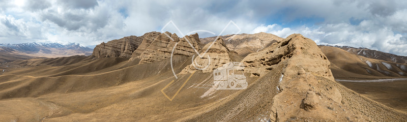 Landscape panorama of cahedral type rock mountain wall along the Kulak-Ashu pass connecting Baetov and Orto-Sirt with Tash-Rabat
