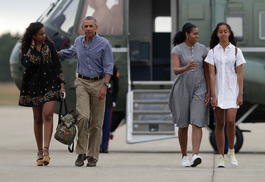 ". President Barack Obama with first lady Michelle Obama and their daughters Malia, right, and Sasha walk on the tarmac to board Air Force One at Air Station Cape Cod in Mass., Sunday, Aug. 21, 2016. Obama is returning from vacation rested and ready for a busy fall, including pressing Congress for money to protect against the Zika virus and fending off lawmakers\' attacks over the administration\'s $400 million ""leverage\"" payment to Iran. (AP Photo/Manuel Balce Ceneta)"