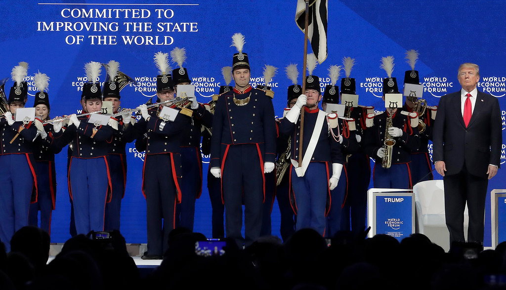 . U.S. President Donald Trump, right, attends a music performance prior to his speech during the annual meeting of the World Economic Forum in Davos, Switzerland, Friday, Jan. 26, 2018. (AP Photo/Markus Schreiber)