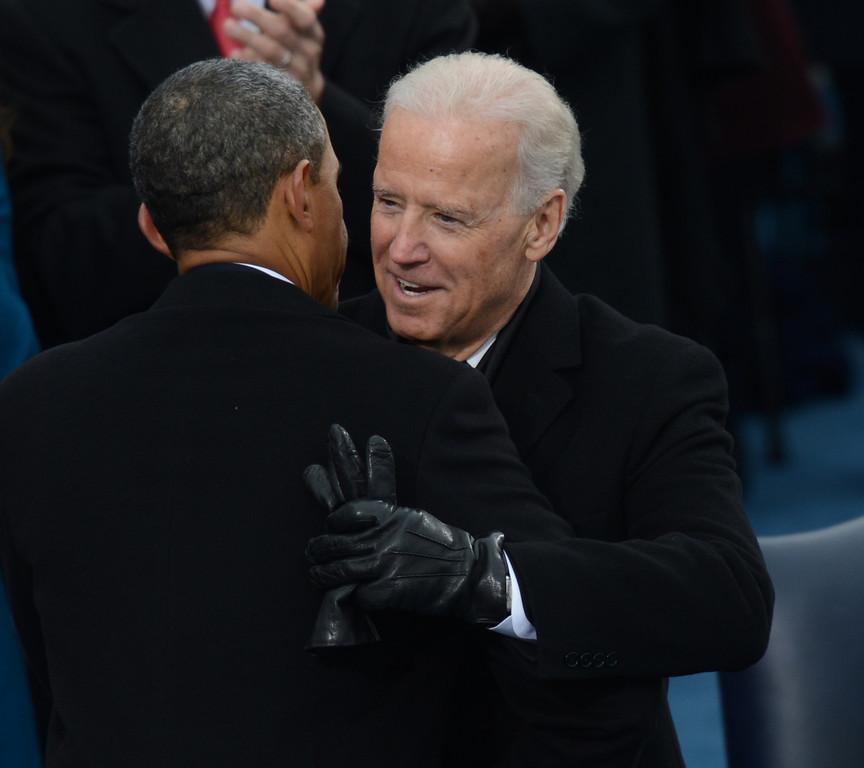 . US President Barack Obama(L) embraces US Vice President Joe Biden after taking the oath of office during the 57th Presidential Inauguration ceremonial swearing-in at the US Capitol on January 21, 2013 in Washington, DC. The oath was administered by US Supreme Court Chief Justice John Roberts, Jr.  SAUL LOEB/AFP/Getty Images