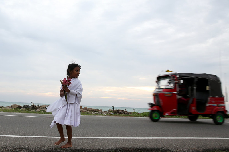 . A Sri Lankan tsunami survivor child attends a Buddhist religious ritual procession as pray for tsunami victims to commemorate the tenth anniversary of the Boxing Day tsunami on December 26, 2014 in Paralliya, Sri Lanka. Sri Lanka was one of the worst hit countries of the 9.1 magnitude quake with around 35,000 deaths. Throughout the affected region of eleven countries, nearly 230,000 people were killed, making it one of the deadliest natural disasters in recorded history.  (Photo by Buddhika Weerasinghe/Getty Images)