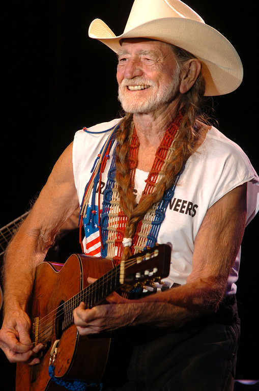 . Willie Nelson performs ``Reinvest in America; Put America Back to Work\'\' event in Charleston, W.Va., Monday, Sept. 6, 2004. (AP Photo/Jon C. Hancock)