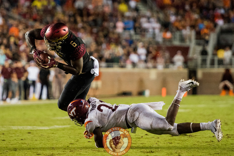 Reggie Floyd (21) tackles Tre' McKitty (6) in the matchup between Virginia Tech and Florida State at Doak Campbell Stadium, Monday, Sept. 3, 2018. (Photo by Cory Hancock)