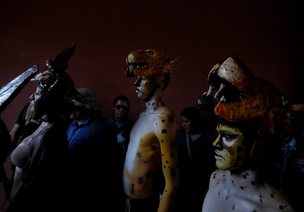 . Performers in costumes take part in a Mayan Culture Festival to commemorate the 13th bak\'tun, an epoch lasting roughly 400 years, in downtown Copan, Honduras, December 20, 2012. On December 21, an era closes in the Maya Long Count calendar, an event that has been likened by different groups to the end of days, the start of a new, more spiritual age or a good reason to hang out at old Maya temples across Mexico and Central America. REUTERS/Jorge Cabrera