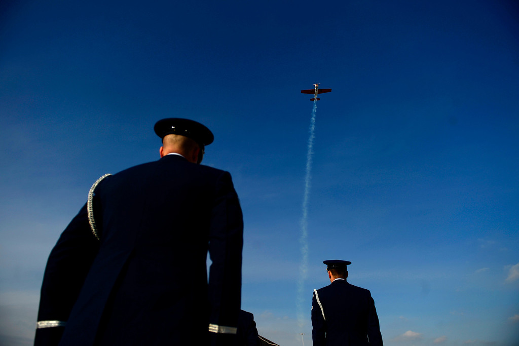 . The Honor Guard watches as a plane performs a flyover during the funeral service for Colonel Fitzroy Newsum at Fort Logan National Cemetery on Monday, January 14, 2013. Newsum, who was 94, served as a Tuskegee Airman during his military service. AAron Ontiveroz, The Denver Post
