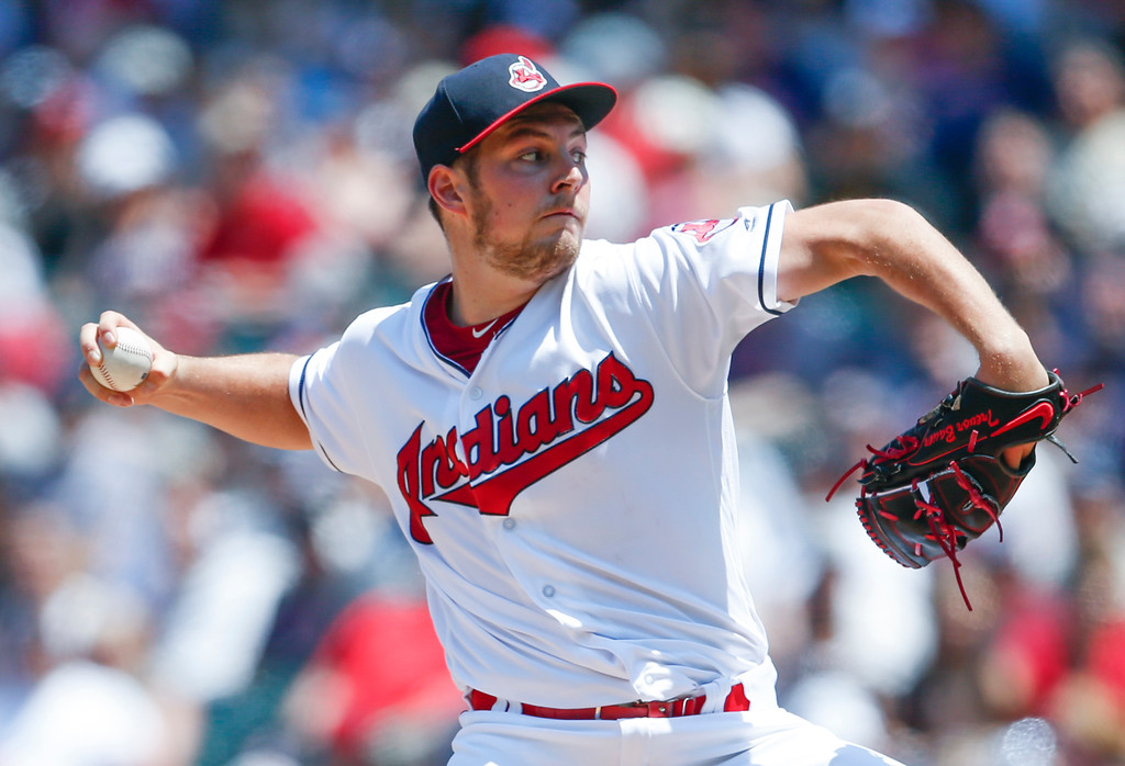 . Cleveland Indians starting pitcher Trevor Bauer delivers against the New York Yankees during the second inning of a baseball game, Sunday, July 15, 2018, in Cleveland. (AP Photo/Ron Schwane)