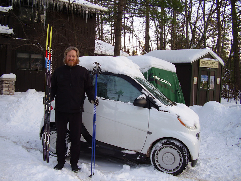 My 206cm Salomon Classic Skis fit just fine in my Smart Car - there is even enough room for another pair of skis plus my son Keefer