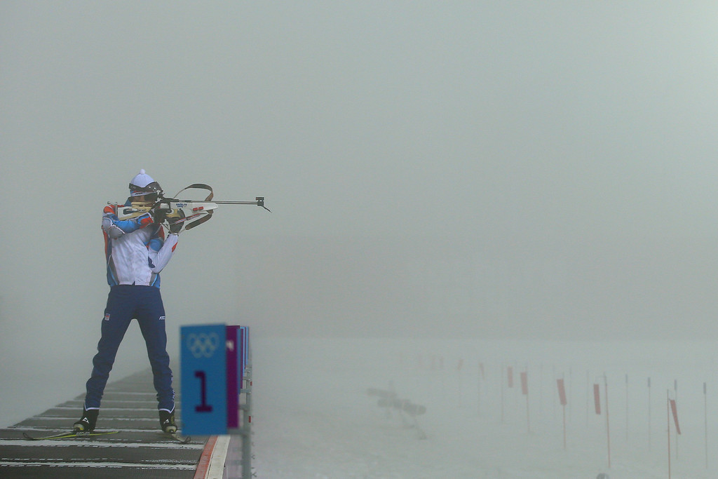 . A competitor checks the visibility through his rifle sights before the competition was postponed due to fog before the Men\'s 15 km Mass Start during day nine of the Sochi 2014 Winter Olympics at Laura Cross-country Ski & Biathlon Center on February 16, 2014 in Sochi, Russia.  (Photo by Richard Heathcote/Getty Images)