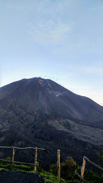 large vocano with smoke and lava coming out of the mouth
