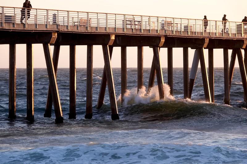 Waves crashing against the Hermosa Beach Pier