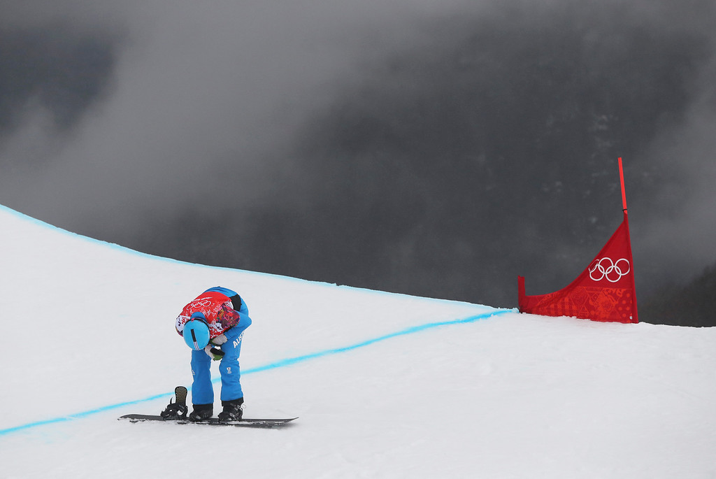 . Austria\'s Markus Schairer reacts after a crash during a men\'s snowboard cross heat at the Rosa Khutor Extreme Park, at the 2014 Winter Olympics, Tuesday, Feb. 18, 2014, in Krasnaya Polyana, Russia. (AP Photo/Sergei Grits)