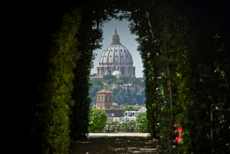 The roof dome of St. Peter's Basilica as seen in Villa Malta & Garden in Rome, Italy