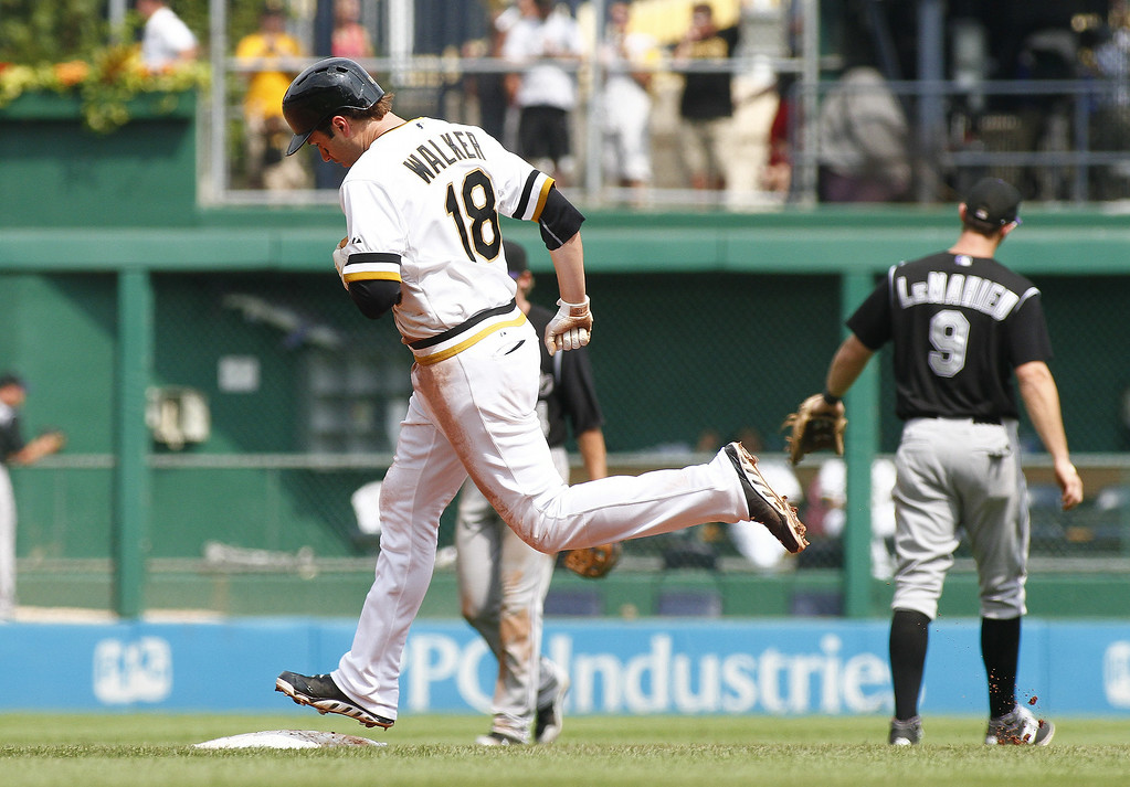 . Neil Walker #18 of the Pittsburgh Pirates rounds second after hitting a solo home run in the seventh inning against the Colorado Rockies during the game at PNC Park on July 20, 2014 in Pittsburgh, Pennsylvania.  (Photo by Justin K. Aller/Getty Images)