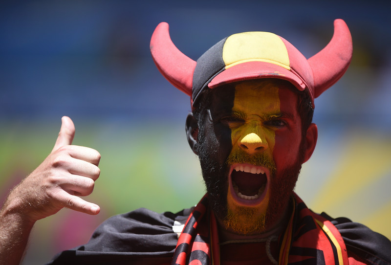 . A Belgian fan cheers before a quarter-final football match between Argentina and Belgium at the Mane Garrincha National Stadium in Brasilia during the 2014 FIFA World Cup on July 5, 2014.  (MARTIN BUREAU/AFP/Getty Images)