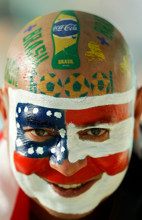 . A U.S. fan waits for the beginning of the World Cup round of 16 soccer match between Belgium and the USA at the Arena Fonte Nova in Salvador, Brazil, Tuesday, July 1, 2014. (AP Photo/Themba Hadebe)