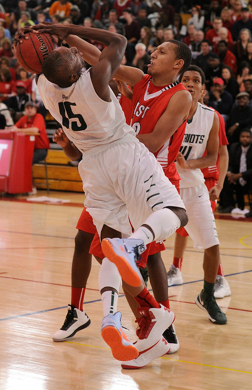 . DENVER, CO. - FEBRUARY 16: Angels defender Tyre Robinson (32) stopped GW forward Jalen Johnson (15) in the first half. The Denver East High School boy\'s basketball team defeated George Washington 82-20 Saturday afternoon, February 16, 2013.  (Photo By Karl Gehring/The Denver Post)