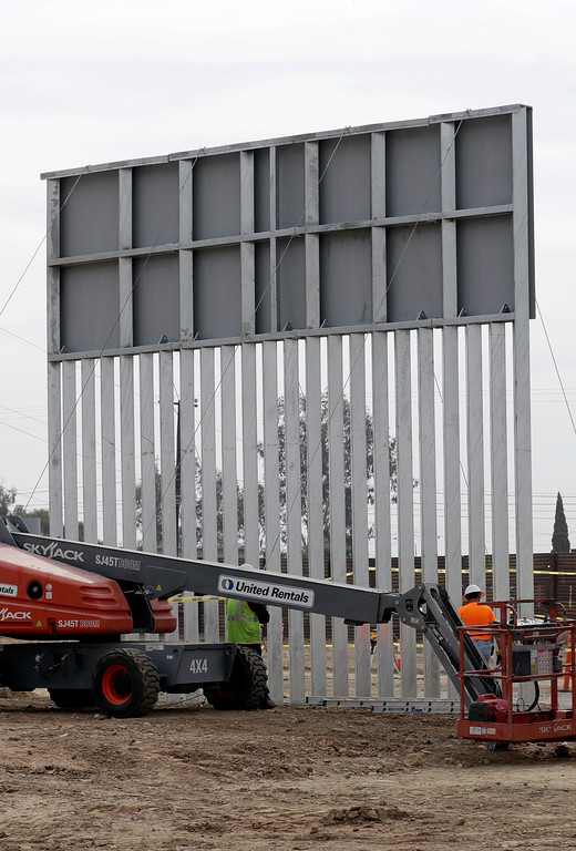 . A border wall prototype stands near the border with Tijuana, Mexico, Thursday, Oct. 19, 2017, in San Diego. Companies are nearing an Oct. 26 deadline to finish building eight prototypes of President Donald Trump\'s proposed border wall with Mexico. (AP Photo/Gregory Bull)
