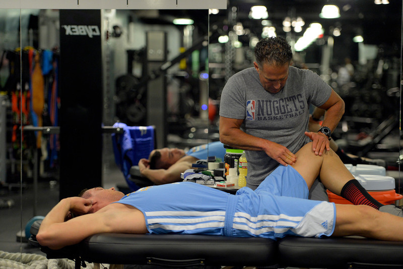 . Denver Nuggets assistant coach/strength and conditioning Steve Hess works on Danilo Gallinari before his workout in the training room, May 27, 2014 at Pepsi Center. (Photo by John Leyba/The Denver Post)