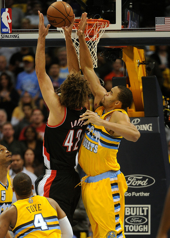 . DENVER, CO. - NOVEMBER 1:  Denver center JaVale McGee, right, rejected an attempt by Portland center Robin Lopez, left, at the hoop in the first half. The Denver Nuggets hosted the Portland Trail Blazers Friday night, November 1, 2013 at the Pepsi Center.  Photo By Karl Gehring/The Denver Post