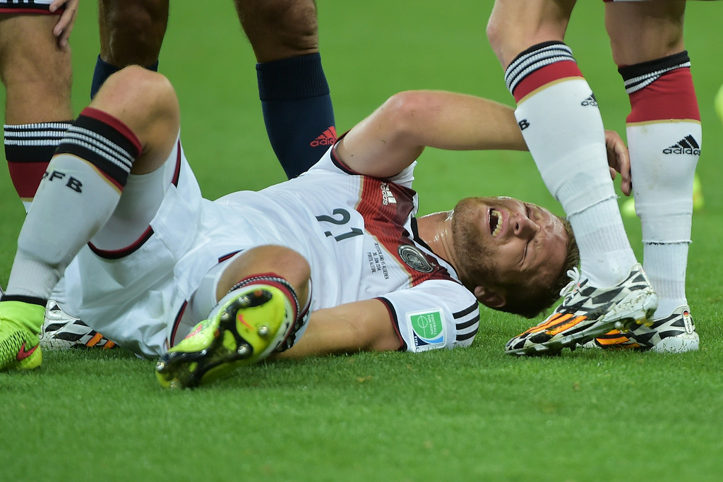 . Germany\'s defender Shkodran Mustafi holds his leg in pain during a Round of 16 football match between Germany and Algeria at Beira-Rio Stadium in Porto Alegre during the 2014 FIFA World Cup on June 30, 2014.   GABRIEL BOUYS/AFP/Getty Images